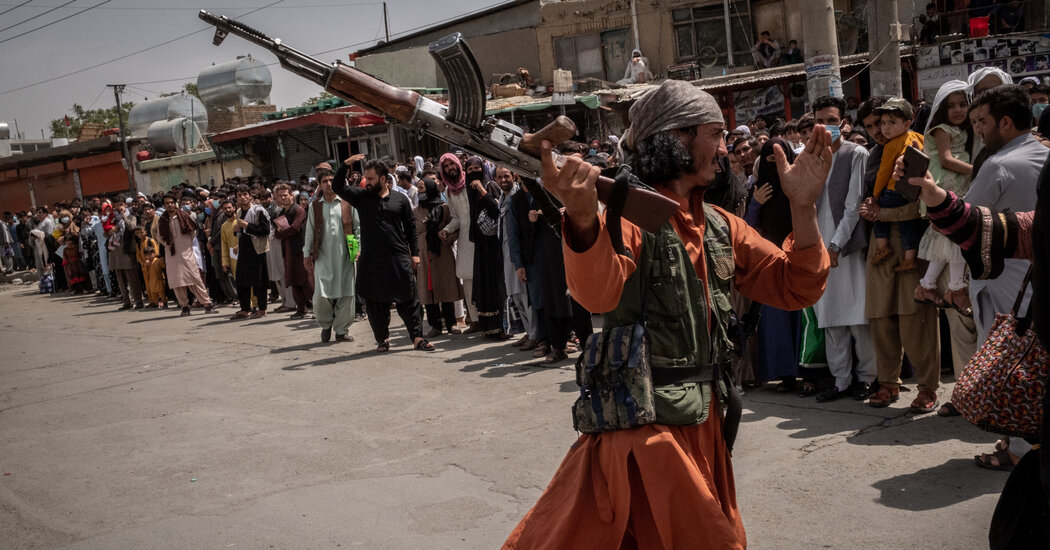 Chaos spreads outside Kabul's airport as the Taliban try to control crowds.