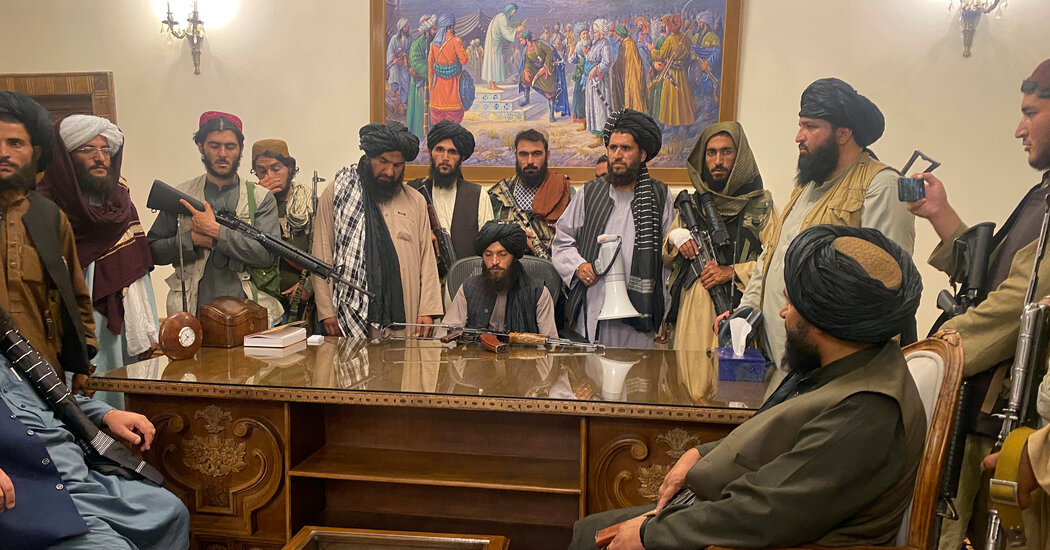 The Taliban take over the presidential palace.